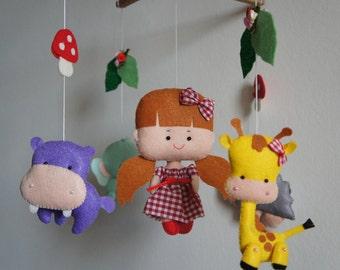 Mobile animals giraffe, elephant, hippopotamus, hedgehog and a girl