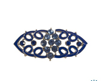 Blue and metal toggle buckle brooch