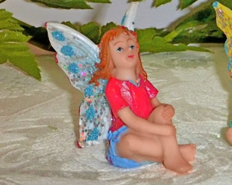 Confetti Fairy. Fairy Figurine - Confetti Series.  Sparkly Fairy.  RED and BLUE with Blue Wings. Red Flowers in her Hair.