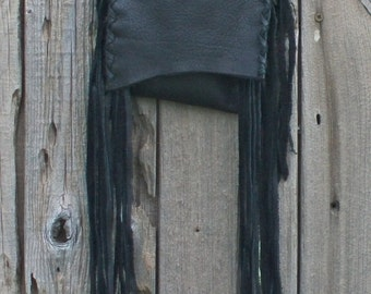 Small black shoulder bag with fringe . Cross body phone bag
