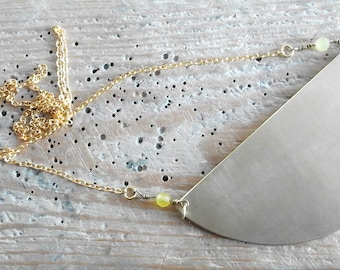 Long necklace with brass central