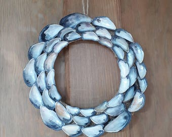 Stunning mussel shell wreath - not just for Christmas! #seashells #coastal #wreath #decoration #seaside