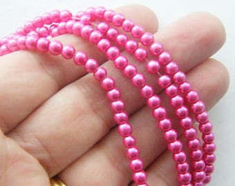 200 Fuchsia imitation glass beads B150