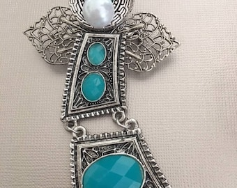 Turquoise and silver angel pin