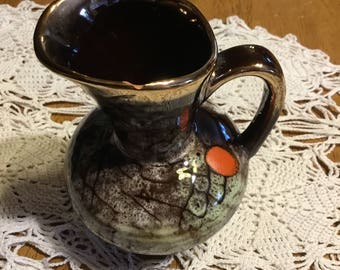 Vintage  Ceramic Pitcher that says Made In Germany and it is numbered 432 . . .