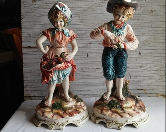 """Vintage 1940s - 1950s Pair of 13"""" Capodimonte Peasants ( young girl and young boy ). A Nice Holiday gift. Great Condition."""