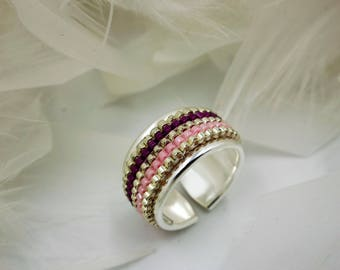 Adjustable ring with woven beads