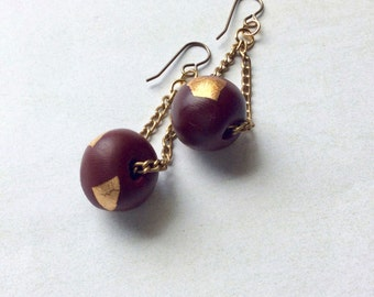 Round, deep burgundy with gold leaf polymer clay dangle earrings.Vintaj east hooks.