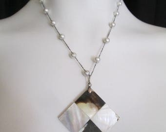 Stunning handcrafted shell pendant Necklace on thin silver and bead chain