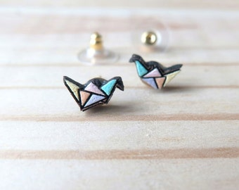 Wood laser-cut origami bird earrings.