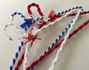 Red, white, and blue nylon covered hangers.