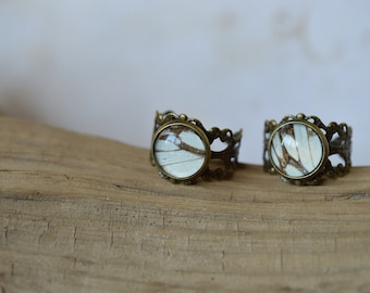Butterfly wing adjustable ring