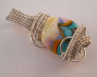 Sterling silver woven pendant with cream, turquoise and orange lampwork bead