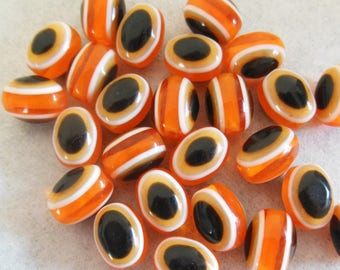 set of 20 plastic orange and black olives beads