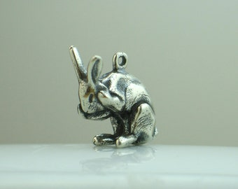 Solid sterling silver cleaning rabbit pendant with antique patina.