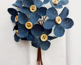 Blue denim flowers with beige button centers, set of 8.  Bendable wire covered stems for gift embellishment or floral arrangements.