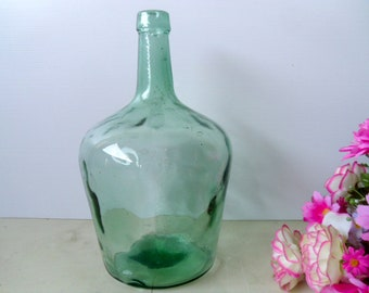 French glass bottle Antique green French wine glass bottle. Vintage large Demi John, green glass wine bottle.
