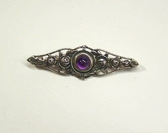 antique sterling silver brooch with amethyst stone
