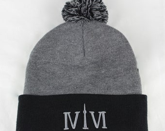 """Black/Heather Grey Toronto 416 toques. The Roman Numerals Stand For 416, With The """"1"""" Resembling The CN Tower."""