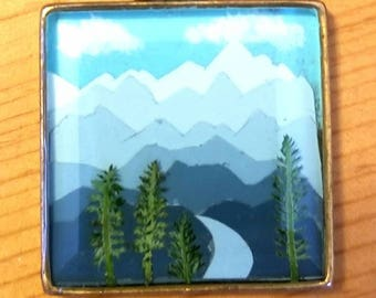 Mountain scene with ferns as trees necklace.