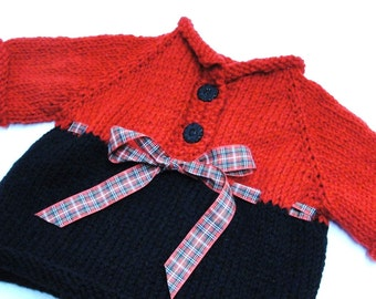 Clearance Sale- hand-knit holiday baby sweater in red and black with plaid ribbon, Ready to ship