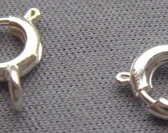 set of 10 white spring snap fasteners