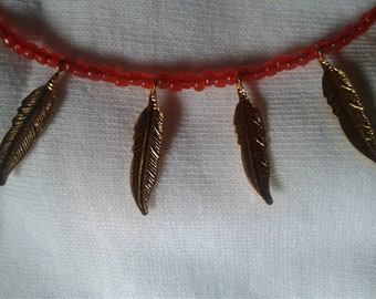 Anklet with golden feathers