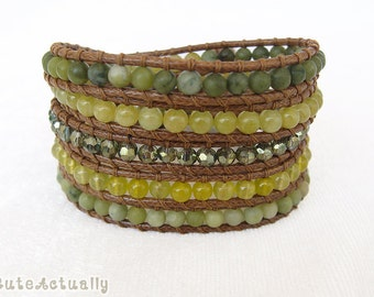 Green stone wrap bracelet with crystal on brown polyester cord