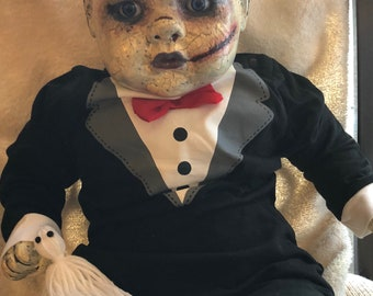 Buster Altered Doll , left at the altar.