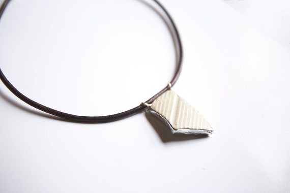 River Pottery Shard Pendant, on thick leather rope.