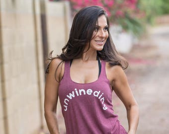 Unwineding. Slouchy Racer Tank. Wine Tank Top. Made in the USA. 8 Colors to Choose From. Women's Wine Shirt. Wine Tank Top. Women's Tank.