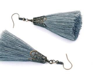 Rustic tassel earrings with copper tone caps