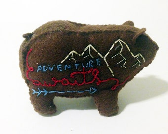 "Brown ""Prone To Wander"" bear with mountain details"