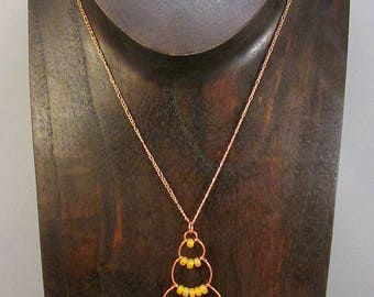 Copper wire bubble necklace with yellow beads