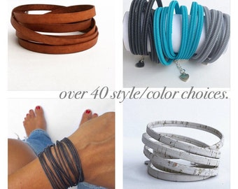 double wrap bracelet in leather round or flat cord, flat cork, or zipper your color choice with lobster clasp chain closure. bangle style bo