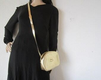 True Vintage 80s Gold shoulder bag crossover bag champ