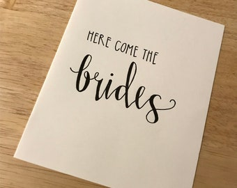 Here come the brides / LGBT wedding / Two brides wedding