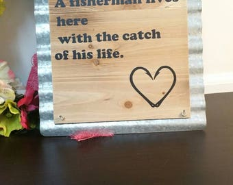 A fisherman lives here with the catch of his life, Home decor, Hanging sign, Fisherman, Funny