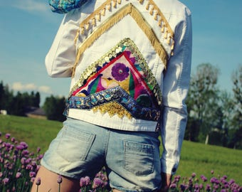 Denim jacket with tassels, fringes, and coins