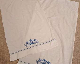 Pair of Vintage Pillowcases with Blue Embroidery Design