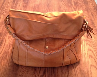 Convertible day bag with braided handle and detatchable strap