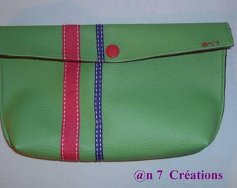 Small pouch green 21 cm by 11 cm to slip into the purse.