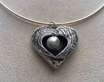 """Sterling silver """"shadow box"""" heart with grey pearl."""