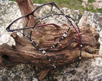 Black pearls and transparent glasses cord