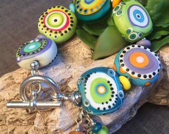 BRIGHT LIGHTS, artisan lampwork and sterling silver bracelet