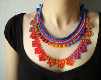 crochet necklace with beaded lace in cornflower blue, indigo, turquoise, crimson red, orange, lime, olive green colors