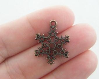 10 Snowflake charms antique copper tone CC2