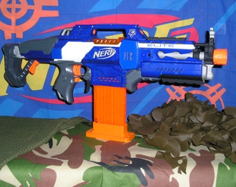 Super Modified Nerf Rapidstrike (Fang ReVamped motors,re-wired,worker parts) 2s lipo.
