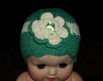 Teal green and white beanie with large white flower