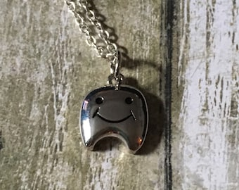 Adorable tooth necklace